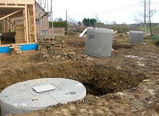 Installation d'une citerne d'eau de pluie enterrée en béton